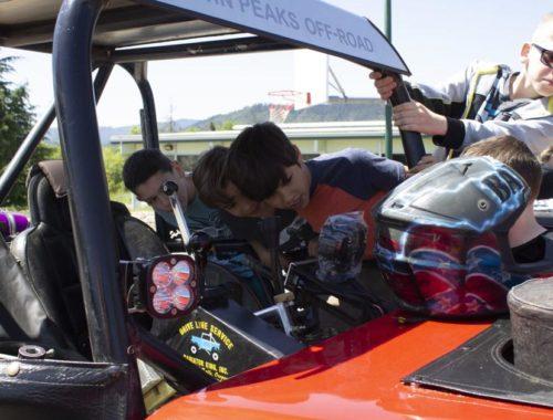 Local racecar drivers speak up against bullying at Lookingglass Elementary School | Education