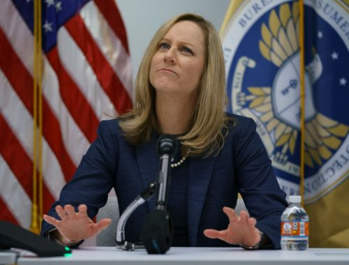 New Bureau of Consumer Financial Protection Director Kathy Kraninger pauses as she speaks to media at the Bureau of Consumer Financial Protection offices in Washington, Tuesday, Dec. 11, 2018. (AP Photo/Carolyn Kaster)
