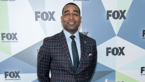 Why did Fox Sports fire FS1 analyst Cris Carter?
