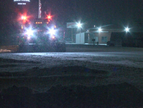 Snow covered roads impact Friday morning travel
