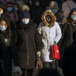 Amid virus fears, China urges workers to skip holiday travel