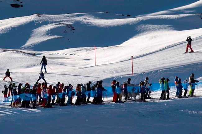 Swiss slopes buzz as those of neighbours sit idle in pandemic