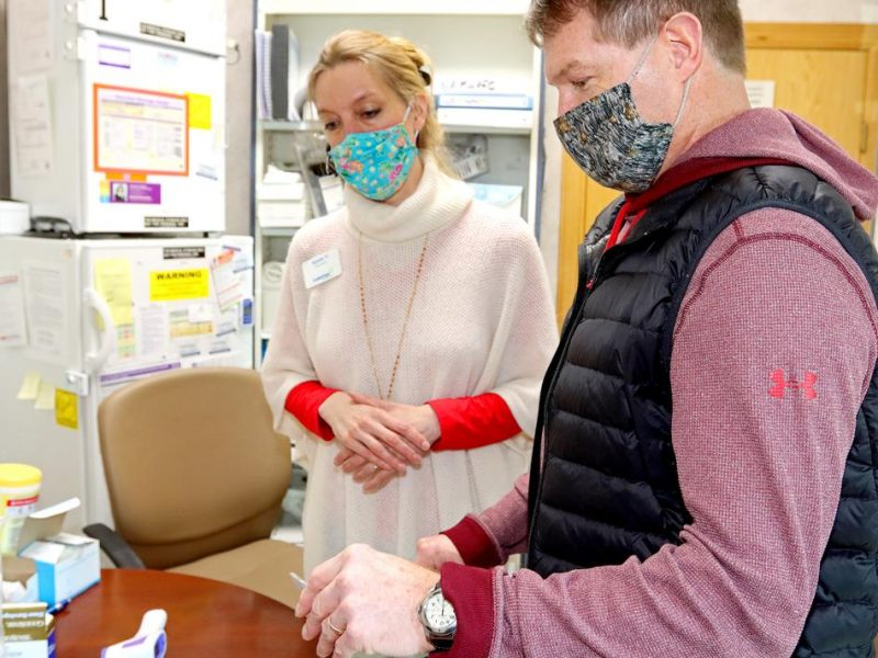 Pharmacists Jayme VanRisseghem (left) and Robert Wennerstrand talk about COVID-19 vaccinations Friday, Feb. 12, at GuidePoint Pharmacy in Brainerd. Kelly Humphrey / Brainerd Dispatch